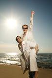 Man giving his girlfriend piggyback ride Stock Image