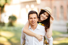 Man giving his pretty girlfriend a piggy back Stock Photography