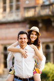 Man giving his pretty girlfriend a piggy back Stock Photos