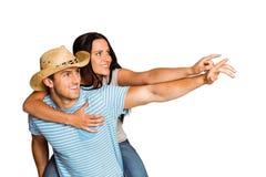 Man giving his pretty girlfriend a piggy back Royalty Free Stock Photos