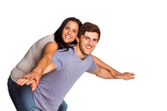 Man giving his pretty girlfriend a piggy back Royalty Free Stock Images