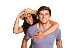 Man giving his pretty girlfriend a piggy back Stock Image
