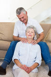 Man giving his relaxed senior wife a shoulder rub Stock Photos