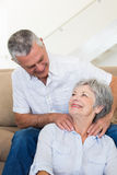 Man giving his senior wife a shoulder rub Stock Photography