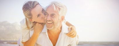 Free Man Giving His Smiling Wife A Piggy Back At The Beach Stock Images - 107030044