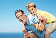 Man giving his son piggy back ride Royalty Free Stock Photography