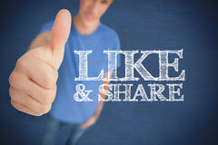 Man giving his thumb up next to like & share Stock Image