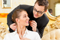 Man giving his wife a necklace Royalty Free Stock Images