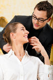 Man giving his wife a necklace Royalty Free Stock Image