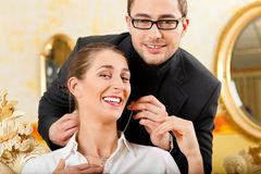 Man giving his wife a necklace Stock Photos