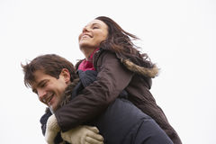 Man Giving His Wife Piggy Back Ride Stock Images