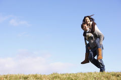 Man Giving His Wife A Piggy Back Ride Stock Photo