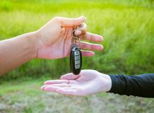 Man is giving key of car to woman Royalty Free Stock Photography