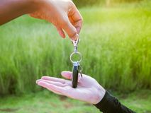Man is giving key of car to woman Royalty Free Stock Photo