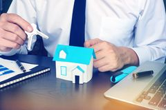 Man giving keys from house in real estate agency. royalty free stock photography