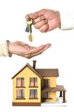 Man giving keys at miniature house Royalty Free Stock Image