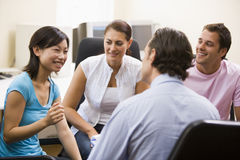 Man giving lecture to three people Stock Photography