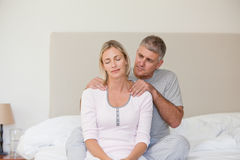 Man giving a massage. To his wife Royalty Free Stock Images