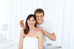 Man giving massage to his wife. At home Stock Photography
