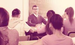 Man giving a math lesson Royalty Free Stock Photos