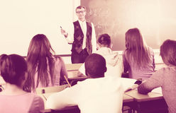 Man giving a math lesson Stock Photography