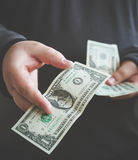 Man giving money one us dollar banknote and holding cash in hands. Money credit Royalty Free Stock Photos