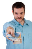Man giving money, smiling Stock Image