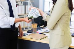 Man giving money woman royalty free stock photography