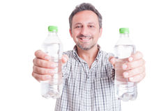 Man giving or offering two bottles of cold water. Stay hydrated during summer heat concept Stock Image