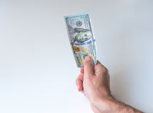 Man giving one hundred US Dollars Stock Photos