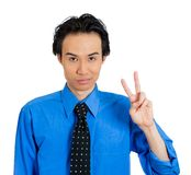 Man giving peace sign Stock Photo