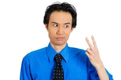 Man giving peace sign Stock Photos