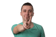 Man Giving Peace Sign - White Background Royalty Free Stock Photo