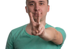 Man Giving Peace Sign - White Background Stock Photos