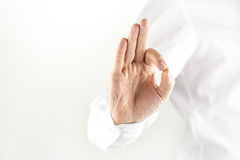 Man giving a perfect gesture Royalty Free Stock Image