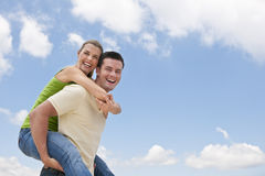 Man Giving Piggy-back Ride Royalty Free Stock Photo