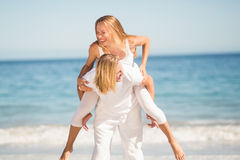 Man giving piggy back ride to woman Stock Image