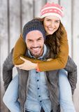 Man giving piggy back to woman Royalty Free Stock Image