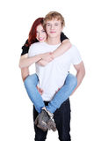 Man giving a piggyback ride to his girlfriend. Stock Image