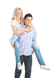 Man giving piggyback ride to his girlfriend Stock Photo