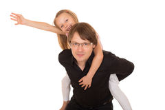Man giving piggyback ride to a little girl Stock Photography