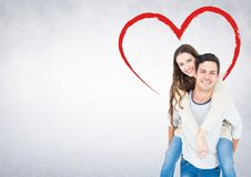 Man giving a piggyback ride to woman Royalty Free Stock Images