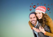 Man giving piggyback ride to woman Stock Photography