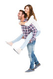 Man giving piggyback ride to woman Royalty Free Stock Images