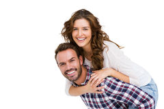 Man giving piggyback ride to woman Stock Images