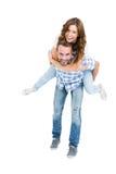 Man giving piggyback ride to woman Stock Photos
