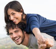 Man Giving Piggyback Ride To Woman Stock Image