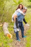 Man giving piggyback to his wife Royalty Free Stock Images