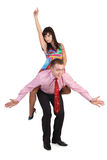 A man giving piggyback to woman. Stock Image