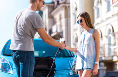 Man giving power cable to woman Stock Photos